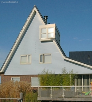 Schilddak met plat dak